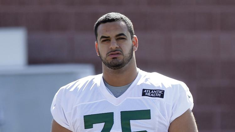 In this Thursday, July 24, 2014 file photo, New York Jets offensive tackle Oday Aboushi (75) walks to practice at Jets NFL football training camp in Cortland, N.Y.  Aboushi was part of a five-day surgical mission by the Islamic Medical Association of North America in early March to repair cleft lips Sudan.   (AP Photo)
