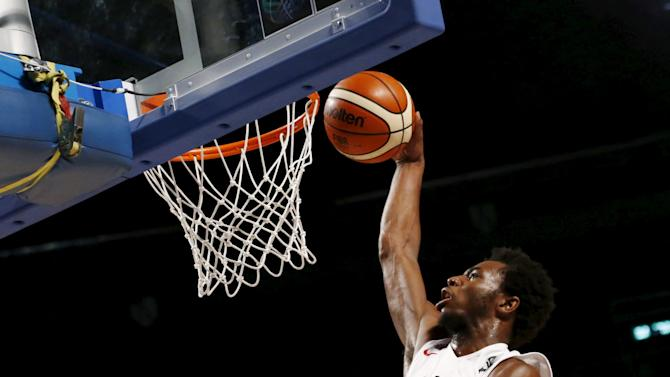 Canada's player Andrew Wiggins leaps to the basket to score against Venezuela