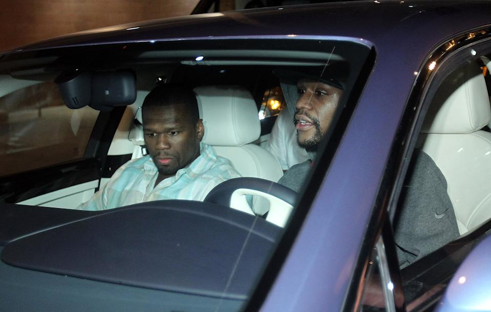 Floyd Mayweather Jr., right, exits the Clark County Detention Center with rapper 50 Cent after serving two months of a three-month sentence in a misdemeanor domestic battery case, Friday, Aug. 3, 2012, in Las Vegas. (AP Photo/Isaac Brekken)