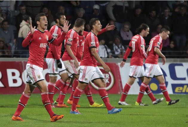 Benfica's Machado celebrates his goal near his teammates during their Portuguese Premier League soccer match against Nacional at Choupana stadium in Funchal