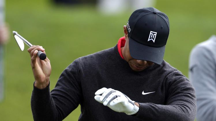 Tiger Woods rehearses his swing while playing the South Course at Torrey Pines during the final round of the Farmers Insurance Open golf tournament in  San Diego, Sunday, Jan. 30, 2011. (AP Photo/Gregory Bull)