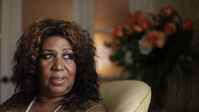 FILE - In a July 26, 2010 file photo, performer Aretha Franklin looks out a window, in Philadelphia.  Aretha Franklin is one of six people who will be inducted into the Gospel Music Hall of Fame on Aug. 14, 2012 in Hendersonville, Tenn.  (AP Photo/Matt Rourke/file)