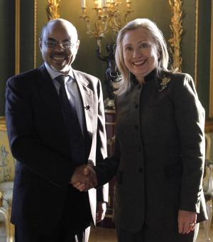 U.S. Secretary of State Hillary Rodham Clinton meets meets Ethiopia's Prime Minister Meles Zenawi, left, at the London Conference on Somalia, Thursday Feb. 23, 2012.  World leaders pledged new help to Somalia to tackle terrorism and piracy, but insisted Thursday that the troubled east African nation must quickly install a permanent government and threatened penalties against those who hamper political progress.  (AP Photo/Jason Reed, Pool)