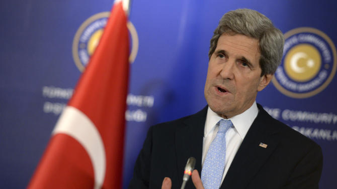 "U.S. Secretary of State John Kerry speaks to the media with Turkish Foreign Minister Ahmet Davutoglu and Syrian opposition leader Moaz al-Khatib, unseen, after a ""Friends of Syria"" group meeting at the Adile Sultan Palace early Sunday, April 21, 2013, in Istanbul, Turkey. The United States said Sunday that it will double its non-lethal assistance to Syria's opposition as the rebels' top supporters vowed to enhance and expand their backing of the two-year battle to oust President Bashar Assad's regime. (AP Photo)"