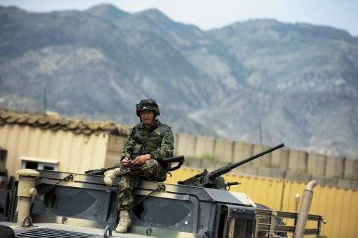 <p>This file photo shows an Afghan soldier sitting on top of a military vehicle at a base in Khost Province, pictured on August 14, 2012. A suicide car bombing hit a US-run base in Khost on Wednesday, killing at least three Afghans and wounding seven others, according to officials.</p>