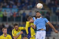Lazio's midfielder Ederson Honorato Campos (R) heads the ball during their Europa League group J football match against Maribor at the Olympic stadium in Rome. Lazio won 1-0