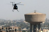 A helicopter belonging to Blackwater scans the streets of central Baghdad in 2005. The US security firm formerly known as Blackwater has agreed to pay a fine of $7.5 million to avoid prosecution for smuggling arms, the US Justice Department said