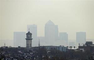 Smog surrounds the Canary Wharf financial district in London