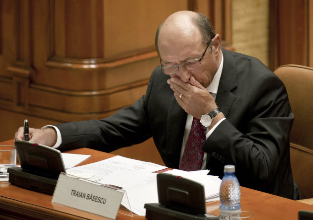 Romanian President Traian Basescu is seen before addressing the country&#39;s parliament prior to a vote to impeach him in Bucharest, Romania, Friday, July 6, 2012. The governing coalition has vowed to go ahead with a vote to impeach President Traian Basescu, as the European Union expressed concern about Romania&#39;s rule of law. If Parliament suspends Basescu, there will be a referendum within 30 days.(AP Photo/Vadim Ghirda)