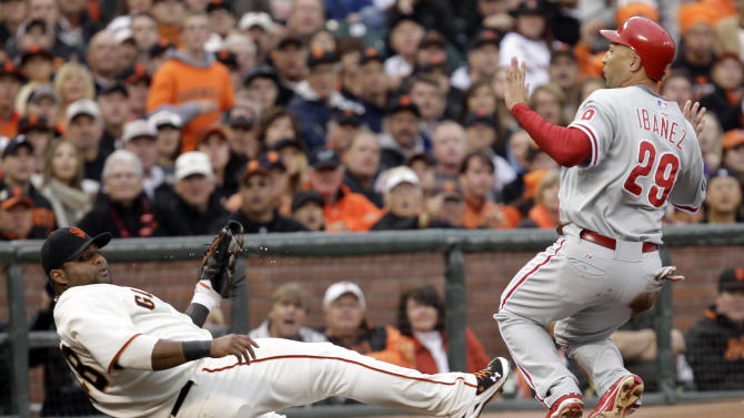 Philadelphia Phillies' Raul Ibanez (29) is safe at third with San Francisco Giants third baseman Pablo Sandoval covering on a bunt by Roy Halladay during the third inning of Game 5 of baseball's National League Championship Series Thursday, Oct. 21, 2010, in San Francisco. (AP Photo/David J. Phillip)