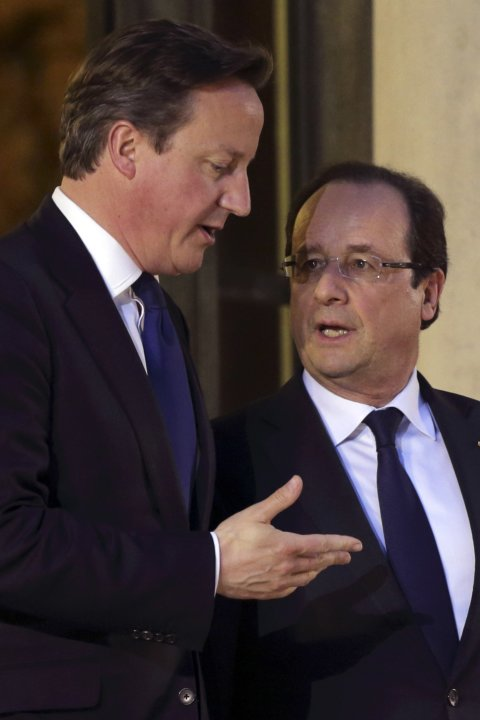France's President Hollande and Britain's Prime Minister Cameron leave the Elysee Palace in Paris