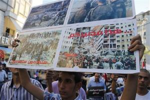An activist holds up a placard during a sit-in near the U.S. embassy in Awkar, against potential U.S. strikes on Syria