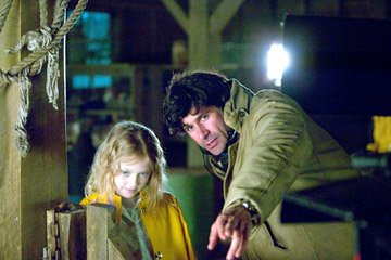 Dakota Fanning and director Gary Winick on the set of Paramount Pictures' Charlotte's Web
