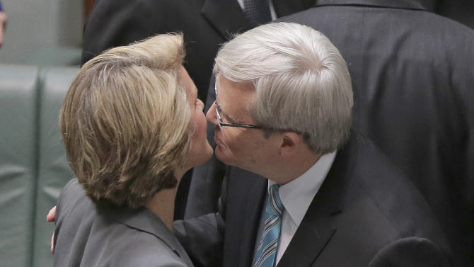 Australian Prime Minister Kevin Rudd kisses the deputy leader of the opposition Julie Bishop just before he addresses Parliament for what is likely to be its last day before elections, in Canberra, Australia, Thursday, June 27, 2013. Rudd was sworn in as Australian prime minister three years and three days after he was ousted from the same job in an internal government showdown. (AP Photo/Rick Rycroft)