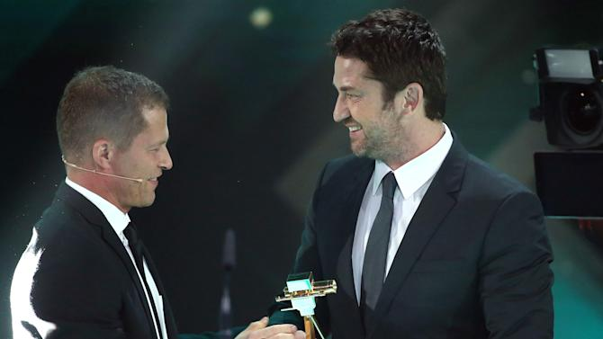 Actor Butler accepts award for Best International Actorduring Golden Camera awards ceremony in Hamburg