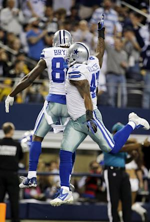 Dallas Cowboys wide receiver Dez Bryant (88) celebrates his touchdown against the Pittsburgh Steelers with Lawrence Vickers (47) during the second half of an NFL football game Sunday, Dec. 16, 2012 in Arlington, Texas. (AP Photo/Tony Gutierrez)