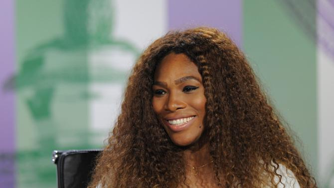 In this photo taken on Sunday, June 23, 2013 and made available by The All England Lawn Tennis & Croquet Club Wimbledon, defending women's champion Serena Williams of the United States speaks to the media during a press conference at Wimbledon. The Championships start Monday, with Serena Williams attempting to win the title for the sixth time. (AP Photo/Jon Buckle/AELTC)
