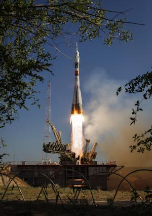 In a photo provided by NASA the Soyuz TMA-04M rocket launches from the Baikonur Cosmodrome in Kazakhstan on Tuesday, May 15, 2012 carrying Expedition 31 Soyuz Commander Gennady Padalka, NASA Flight Engineer Joseph Acaba and Flight Engineer Sergei Revin to the International Space Station.  (AP Photo/NASA, Bill Ingalls)