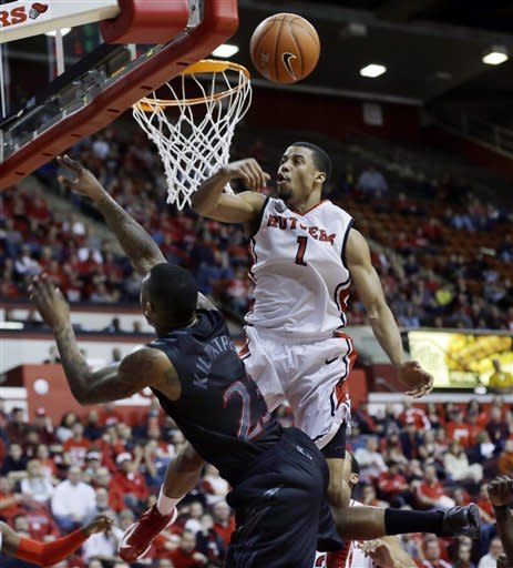 No. 21 Cincinnati beats Rutgers 68-58