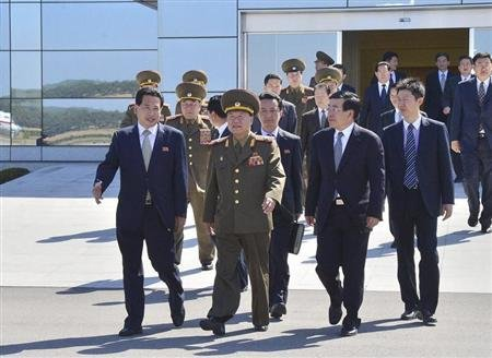 Choe, director of the General Political Bureau of the Korean People's Army of North Korea, walks at Pyongyang airport before leaving for China