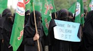 "Activists from the Islamic Sunni Tehreek party protest in Islamabad on Sunday against the assassination attempt by Taliban on child activist Malala Yousafzai. The Pakistani schoolgirl is in a ""stable"" condition and making steady progress in her recovery, the military said Sunday"