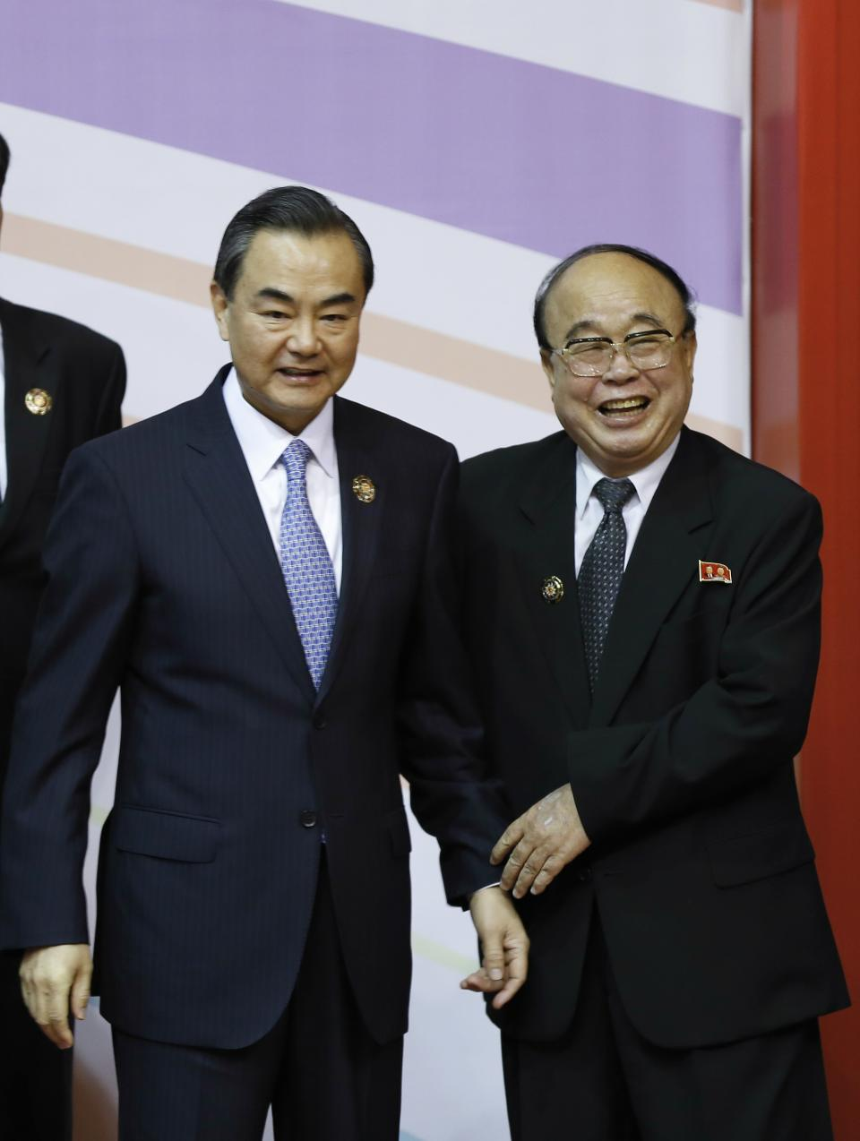 China's Foreign Minister Wang Yi, left, and North Korea's Foreign Minister Pak Ui Chun pose during a group photo session for ASEAN Regional Forum Foreign Ministers' Meeting in Bandar Seri Begawan, Brunei, Tuesday, July 2, 2013. (AP Photo/Vincent Thian)