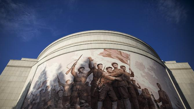 A mural decorates War Museum during a government organised tour for foreign reporters in Pyongyang