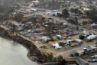 <p>Aerial photo, taken on January 5, 2013, shows the town of Dunalley after bush-fires swept through Tasmania. Australian police said many people remained unaccounted for by Monday but no deaths had yet been recorded in fire-ravaged Tasmania, as the rest of the nation braced for a dangerous heatwave.</p>