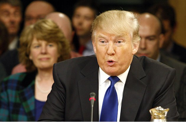 In this photo released by the Scottish Parliament dated Wednesday April 25, 2012, US business magnate Donald Trump gives evidence to the Scottish Parliament's Economy Energy and Tourism Committee in E