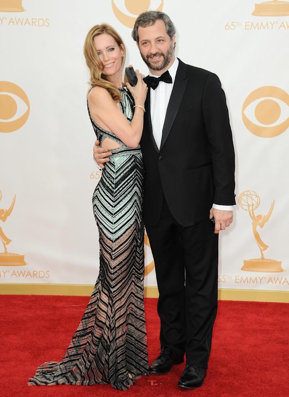 Leslie Mann, left, and Judd Apatow arrive at the 65th Primetime Emmy Awards at Nokia Theatre on Sunday Sept. 22, 2013, in Los Angeles. (Photo by Jordan Strauss/Invision/AP)