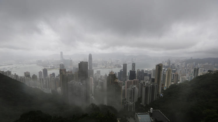 HK buttons up as typhoon passes on way to China