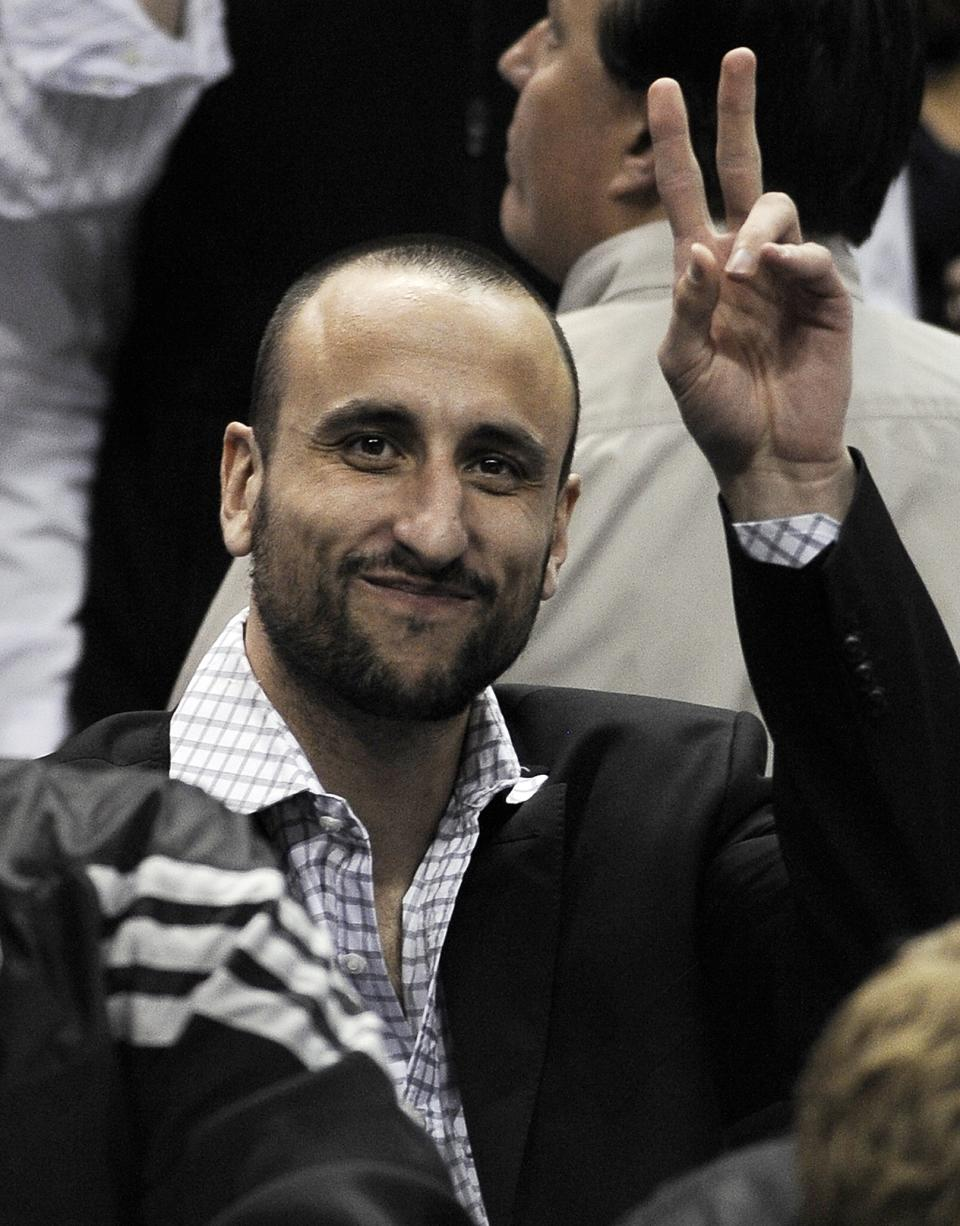 San Antonio Spurs' Manu Ginobili, of Argentina, gestures from behind the bench during the first half of an NBA basketball game against the Chicago Bulls, Wednesday, Feb. 29, 2012, in San Antonio. (AP Photo/Darren Abate)