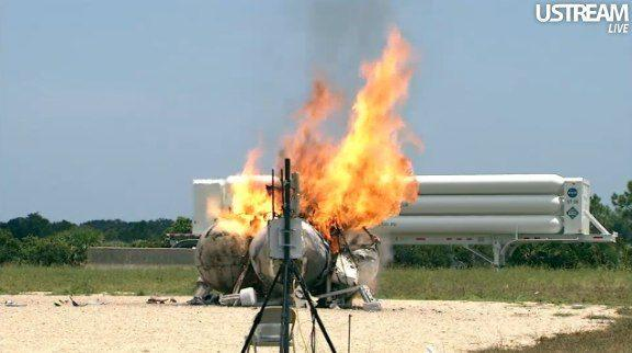 In this still image made from video provided by NASA, the methane-powered Morpheus lander burns after it crashed in a test flight at Kennedy Space Center in Florida Thursday, Aug. 9, 2012. NASA spokeswoman Lisa Malone says nobody was hurt, but it appears the prototype lander is a total loss. (AP Photo/NASA)