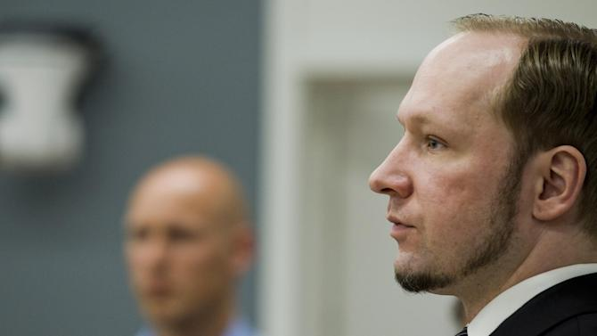 Anders Behring Breivik, right, pictured in the courtroom in Oslo Wednesday May 23, 2012 as his trial continues. The terror trial continues against the anti-Muslim fanatic, Breivik, who has confessed to killing 77 people in July 2011, when he 8 people by setting off a bomb in central Oslo, and then shot to death 69 people on Utoya island, outside the Norwegian capital. (AP Photo / Berit Roald, NTB scanpix POOL)