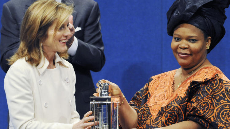 FILE - In this May 18, 2009 file photo, Caroline Kennedy, president of the Kennedy Library Foundation, left, stands with Liberian peace activist Leymah Gbowee after Gbowee was awarded the John F. Kennedy Profile in Courage Award at the John F. Kennedy Presidential Library and Museum, in Boston. Liberian President Ellen Johnson Sirleaf, Liberian activist Leymah Gbowee and Tawakkul Karman of Yemen have won the 2011 Nobel Peace Prize, the Norwegian Nobel Committee announced Friday, Oct. 7, 2011. (AP Photo/Lisa Poole, File)