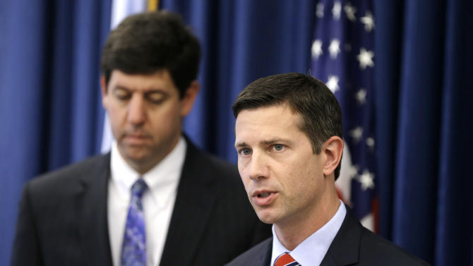 FBI Assistant special agent Eric Smith, right, answers questions during a news-conference Tuesday, June 18, 2013, in Cleveland. U.S. attorney Steven M. Dettelbach, left, listens. Authorities in Ohio have arrested three people on charges of enslaving a mentally disabled young mother and her daughter over a two-year period. Federal agents and Ashland police said Tuesday the trio forced the woman to do housework, threatened her and the girl with violence and fed their pets better than the victims. (AP Photo/Tony Dejak)