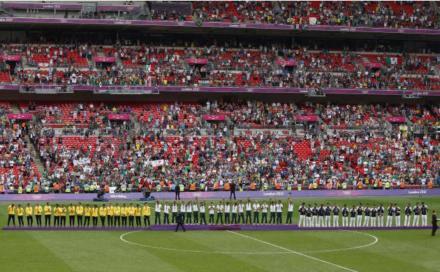 Silver medallists Brazil, gold medallists Mexico and bronze medallists South Korea stand on the medal podiums during the soccer medal award ceremony  at Wembley Stadium during the London 2012 Olympic