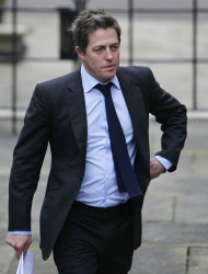FILE - This is a Monday, Nov. 21, 2011 file photo of British actor Hugh Grant as he arrives to give evidence at the the Leveson inquiry in London. Celebrities including author J.K. Rowling and actor Hugh Grant are accusing the government of letting down victims of media intrusion. They are urging lawmakers to back new measures to rein in Britain's unruly press. (AP Photo/Alastair Grant, File)