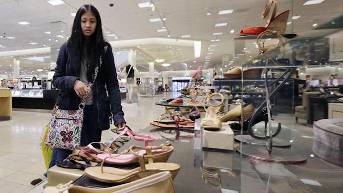 In this Thursday, March 28, 2013, photo, a woman shops at a Nordstrom store in Chicago. The Federal Reserve reports how much consumers borrowed in March on Tuesday, May 7, 2013. (AP Photo/Nam Y. Huh)