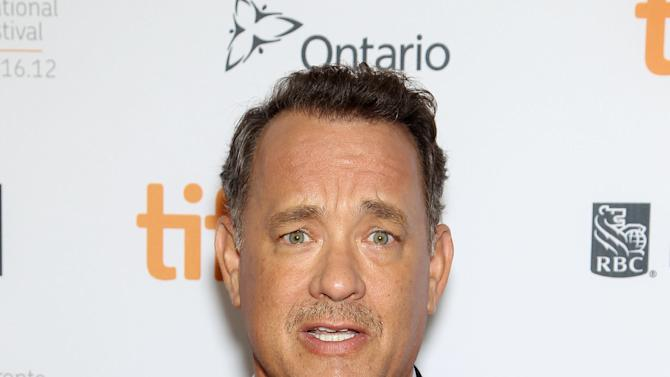 """FILE - This Sept. 8, 2012 file image released by Stapix shows actor Tom Hanks at the premiere of """"Cloud Atlas,"""" at the Toronto International Film Festival in Toronto. Hanks will play a gutsy New York City newspaper columnist when he makes his debut on Broadway in the spring. Producers of Nora Ephron's play """"Lucky Guy"""" announced Thursday that Hanks will play Mike McAlary in the stage biography. Hanks, a two-time Oscar winner, had been in negotiations for the role when Ephron died this summer.  Previews begin March 1 at the Broadhurst Theatre and an opening night is set for April 1. (AP Photo/Starpix, Marion Curtis, file)"""