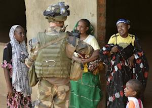A Chadian Muslim family is protected by a French soldier …
