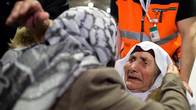 107-year-old Syrian Sabria Khalaf, right, is greeted by a family member as she arrives at the airport in Duesseldorf, Germany, Monday, March 17, 2014. The woman who fled the conflict in Syria has been reunited with her family in Germany. German officials say Khalaf arrived from Greece where she had originally applied for asylum. (AP Photo/dpa, Federico Gambarini)