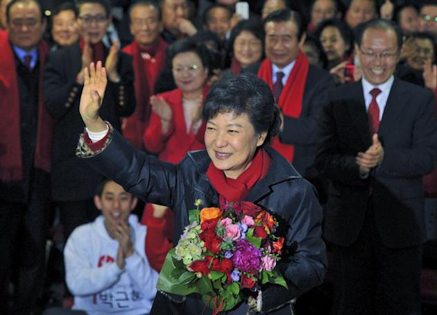 South Korea's presidential candidate Park Geun-Hye of ruling Saenuri Party, waves to supporters after arriving at the party headquarters in Seoul, South Korea, on Wednesday Dec. 19, 2012.   Liberal So
