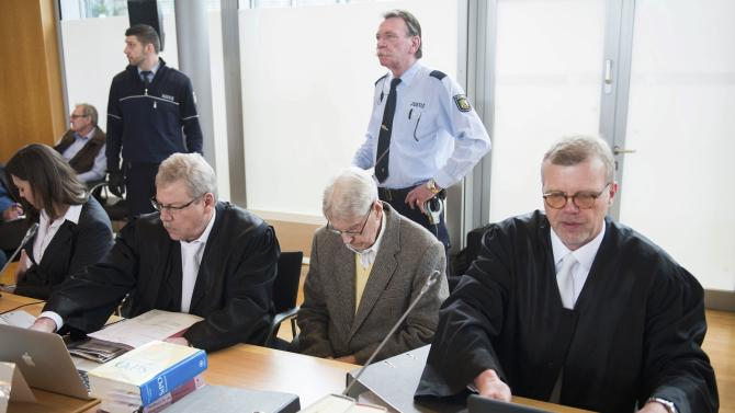 Reinhold H., a 94-year-old former guard at Auschwitz sits between his lawyers Scharmer and Salmen in the courtroom before his trial in Detmold