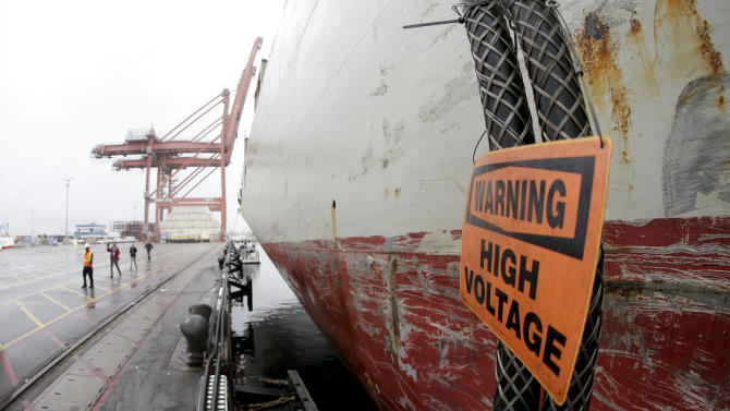 In Calif, some ships plug in to power up