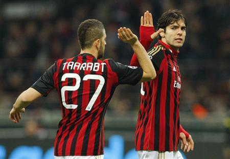 AC Milan's Kaka (R) high fives Adel Taarabt during their Champions League round of 16 first leg soccer match against Atletico Madrid at the San Siro stadium in Milan February 19, 2014. REUTERS/Ale