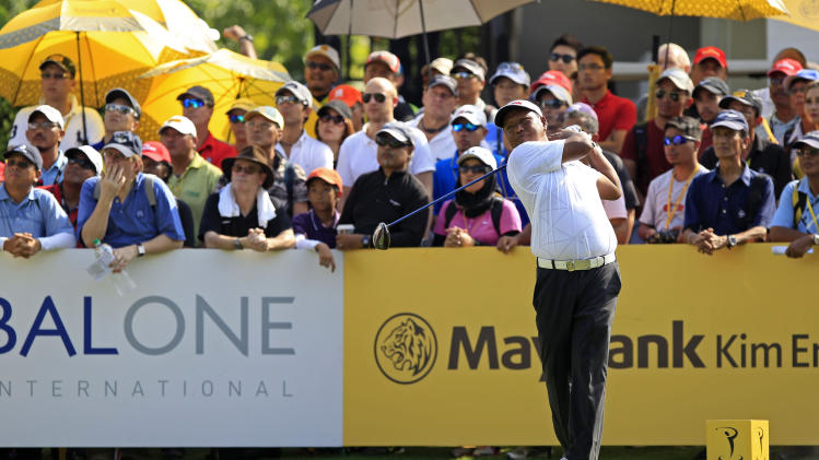 Antonio Lascuna of the Philippine tees off on the first hole during the third round of the Malaysian Open golf tournament at Kuala Lumpur Golf and Country Club in Kuala Lumpur, Malaysia, Saturday, April 19, 2014. (AP Photo/Lai Seng Sin)