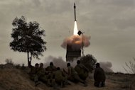 Israeli soldiers watch as a missile is launched from the Iron Dome defence system in the southern Israeli city of Beer Sheva in March 2012. Israel on Sunday began testing an SMS system for warning the public of an imminent missile attack as chatter over a possible strike on Iran dominated the Israeli press headlines