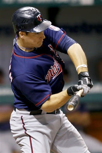 Willingham has 3 RBIs in Twins' win