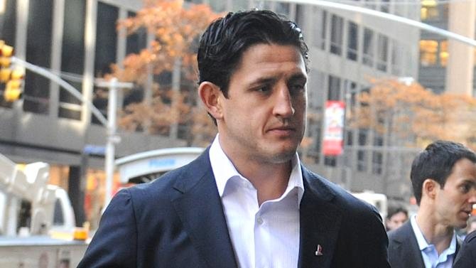 Edmonton Oilers hockey player Shawn Horcoff arrives for labor talks at NHL headquarters in New York, Wednesday, Nov. 21, 2012, in New York. (AP Photo/ Louis Lanzano)